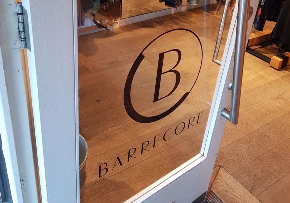 Branded vinyls on Barecore glass door