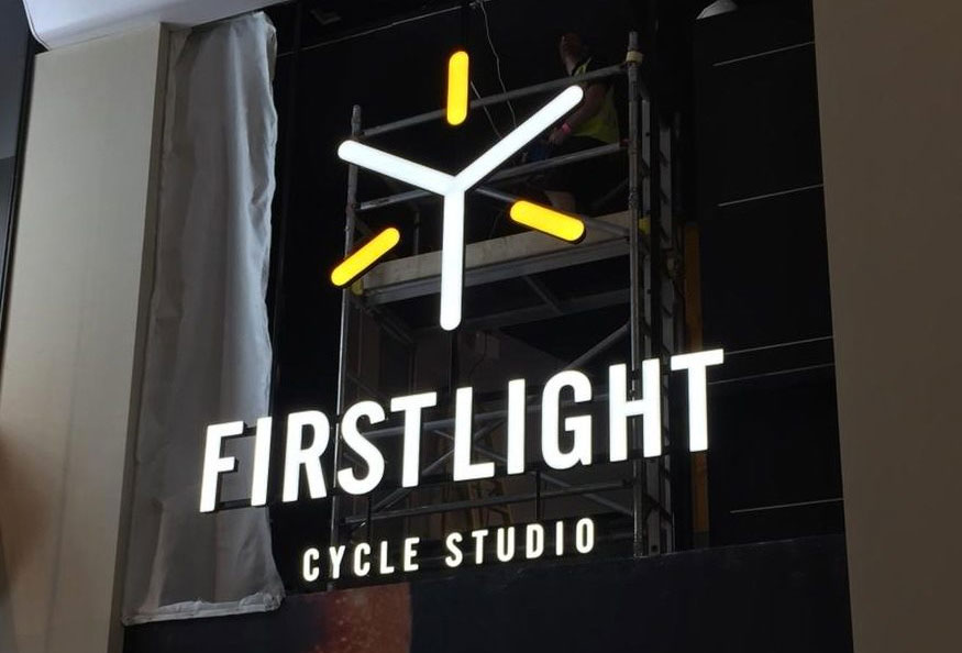 First Light illuminated logo and lettering