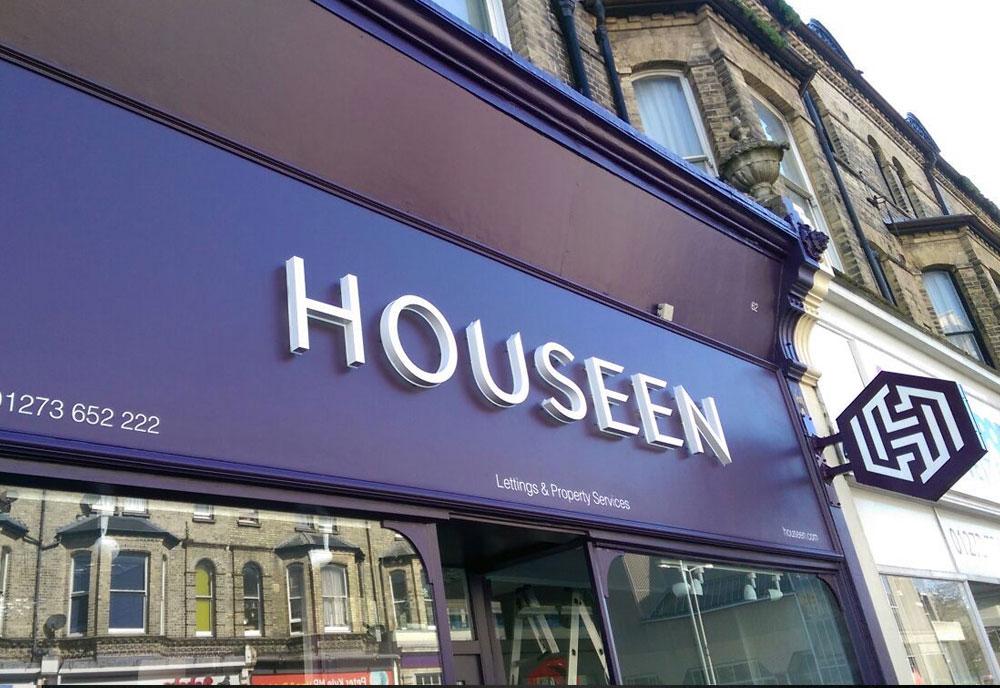 Housseen Estate Agents sign