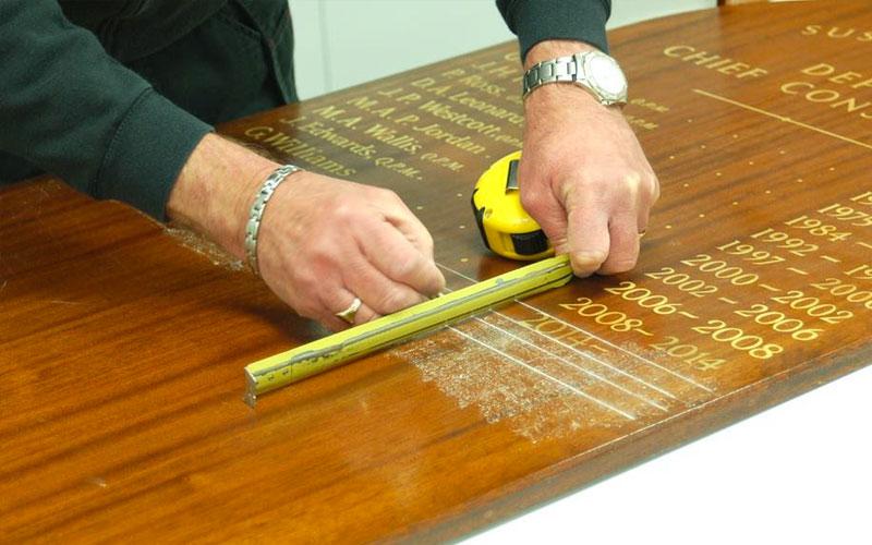Traditional signwriting members board